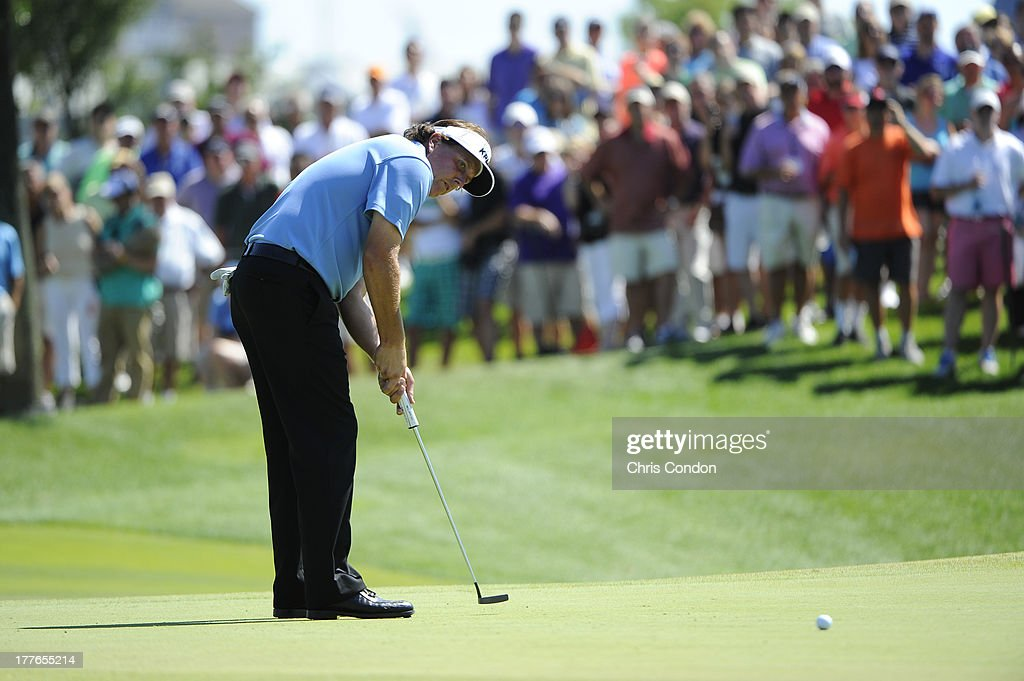 Phil Mickelson putts for birdie on the 16th green during the final round of The Barclays at Liberty National Golf Club on August 25, 2013 in Jersey City, New Jersey.
