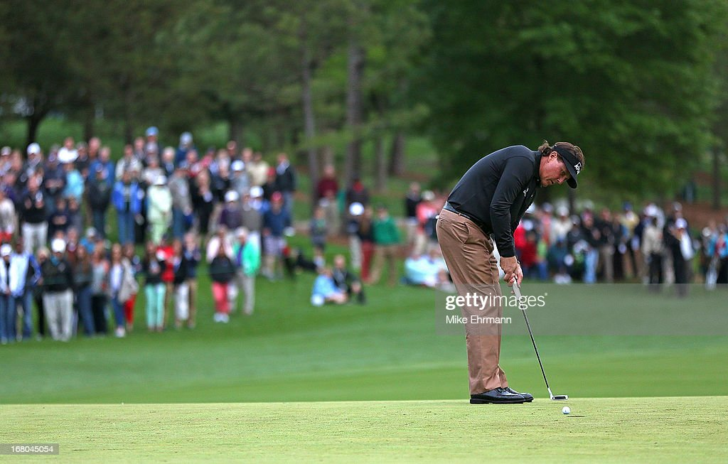 Phil Mickelson putts on the 14th hole during the third round of the Wells Fargo Championship at Quail Hollow Club on May 4, 2013 in Charlotte, North Carolina.