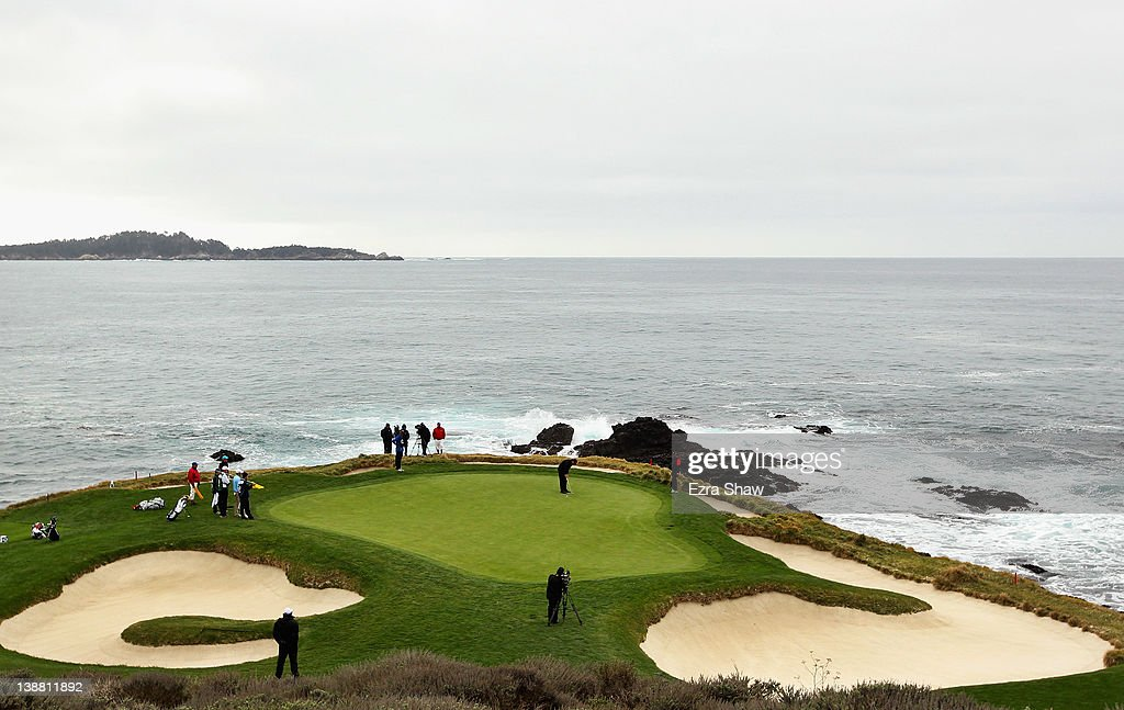 Phil Mickelson putts on the seventh green during the final round of the ATT Pebble Beach National ProAm at Pebble Beach Golf Links on February 12...