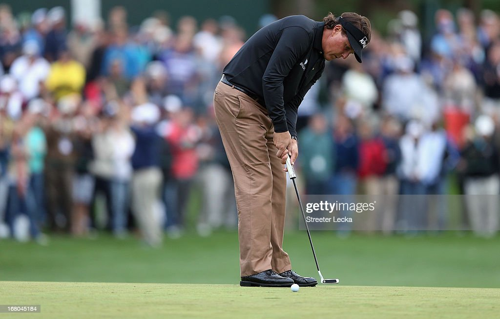 Phil Mickelson putts the ball on the 18th green during the third round of the Wells Fargo Championship at Quail Hollow Club on May 4, 2013 in Charlotte, North Carolina.
