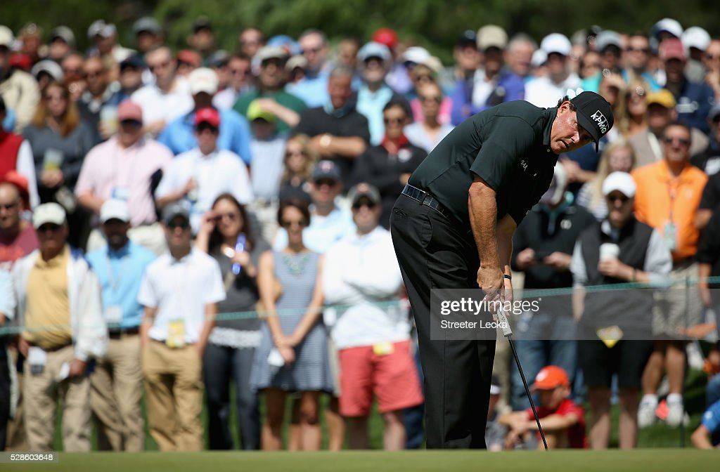 Phil Mickelson putts the ball on the fourth hole during the second round of the 2016 Wells Fargo Championship at Quail Hollow Club on May 6, 2016 in Charlotte, North Carolina.