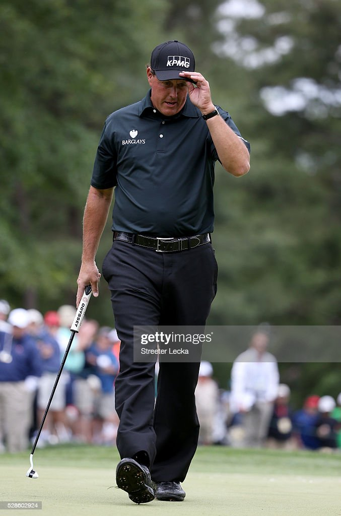 Phil Mickelson reacts after a putt on the fifth hole during the second round of the 2016 Wells Fargo Championship at Quail Hollow Club on May 6, 2016 in Charlotte, North Carolina.