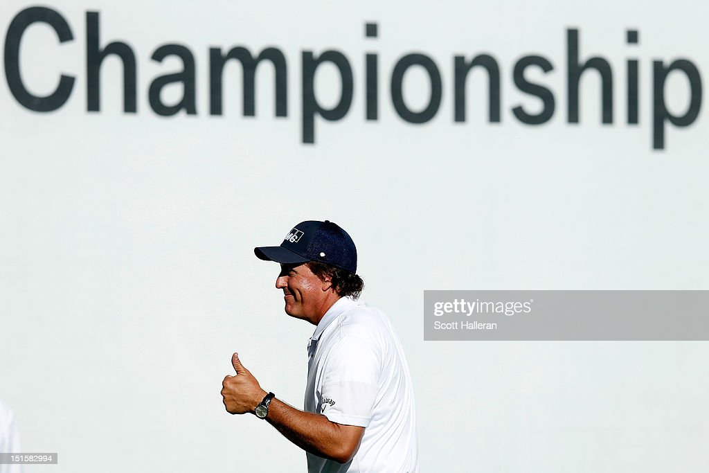 Phil Mickelson reacts after he made a birdie putt on the 18th green during the third round of the BMW Championship at Crooked Stick Golf Club on...