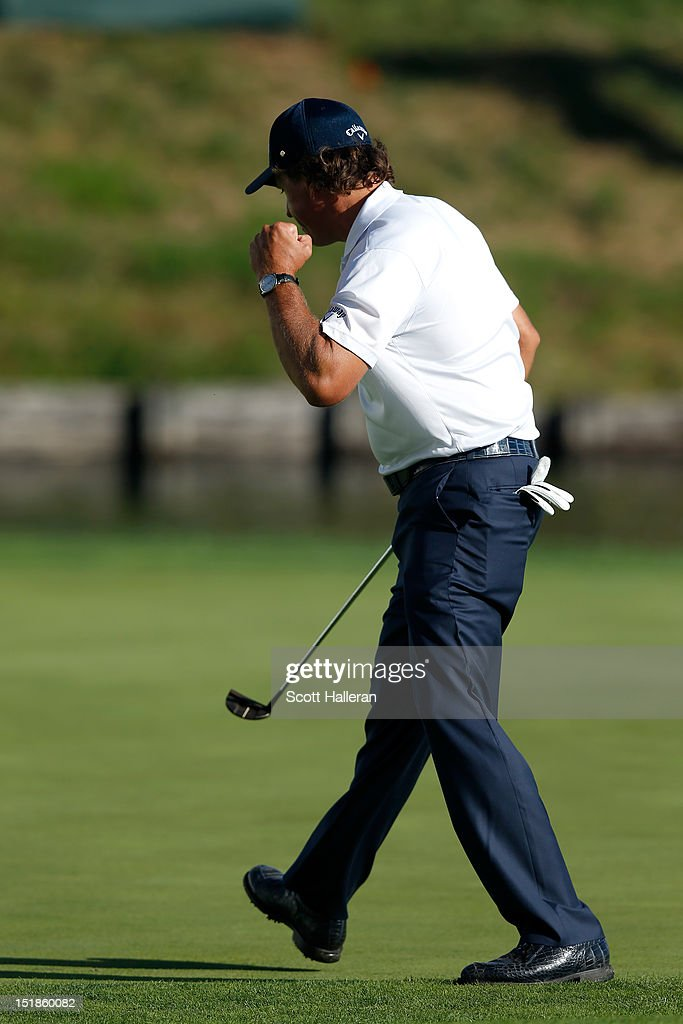 <a gi-track='captionPersonalityLinkClicked' href=/galleries/search?phrase=Phil+Mickelson&family=editorial&specificpeople=157543 ng-click='$event.stopPropagation()'>Phil Mickelson</a> reacts after he made a birdie putt on the 18th hole green during the third round of the BMW Championship at Crooked Stick Golf Club on September 8, 2012 in Carmel, Indiana.
