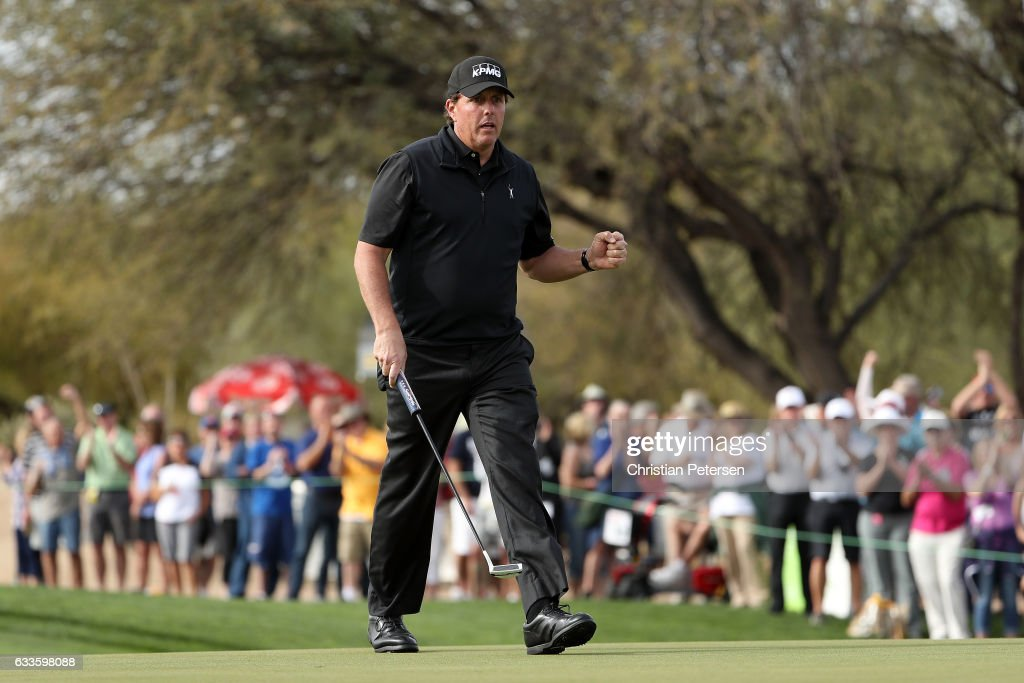 Phil Mickelson reacts after making his birdie putt on the ninth green during the first round of the Waste Management Phoenix Open at TPC Scottsdale on February 2, 2017 in Scottsdale, Arizona.