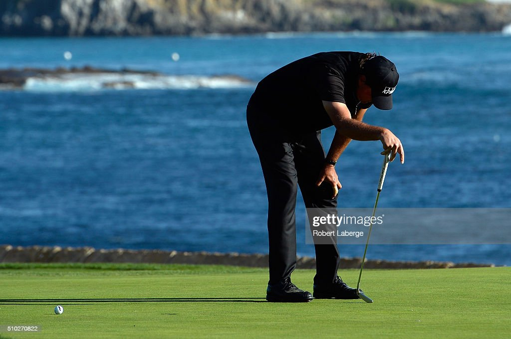 Phil Mickelson reacts after missing a birdie putt on the 18th green that would have forced a playoff with Vaughn Taylor (not pictured) during the final round of the AT&T Pebble Beach National Pro-Am at the Pebble Beach Golf Links on February 14, 2016 in Pebble Beach, California.