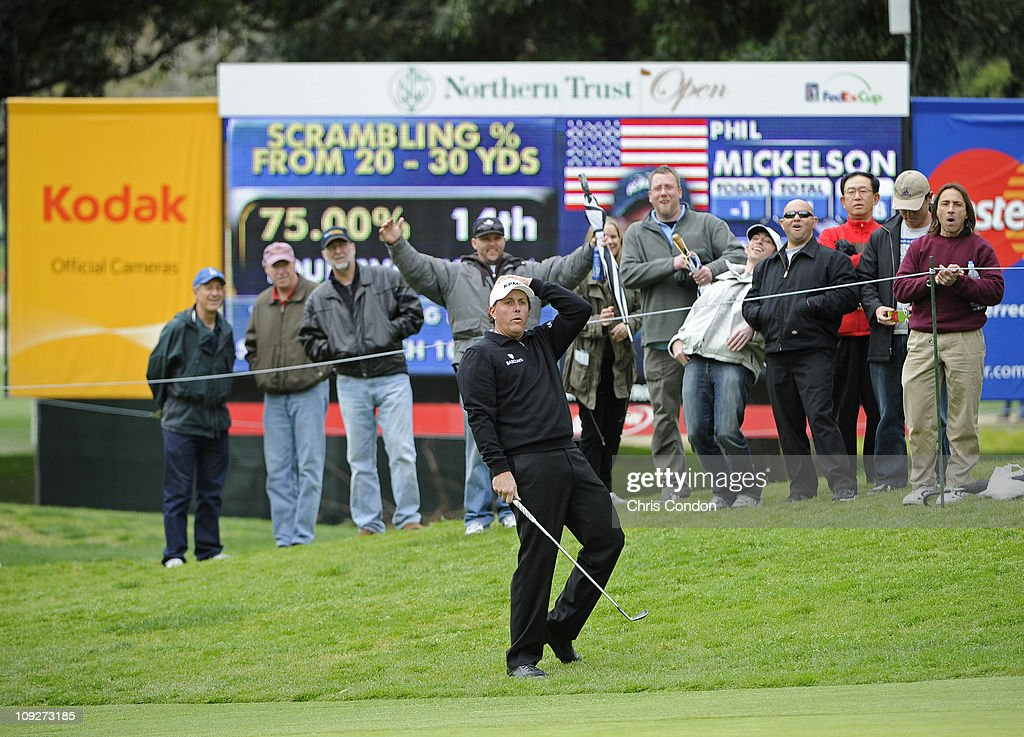 Phil Mickelson reacts after nearly holing out a chip on the 11th hole during the second round of the Northern Trust Open at Riviera Country Club on February 18, 2011 in Pacific Palisades, California.