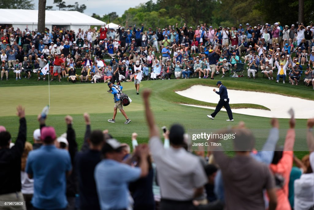 Phil Mickelson reacts after putting for birdie on the fifth green during round three of the Wells Fargo Championship at Eagle Point Golf Club on May 6, 2017 in Wilmington, North Carolina.