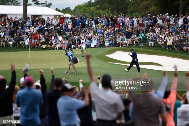 Phil Mickelson reacts after putting for birdie on the fifth green during round three of the Wells Fargo Championship at Eagle Point Golf Club on May...