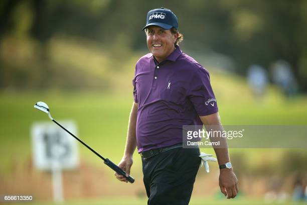 Phil Mickelson reacts after putting on the 15th hole of his match during round one of the World Golf ChampionshipsDell Technologies Match Play at the...