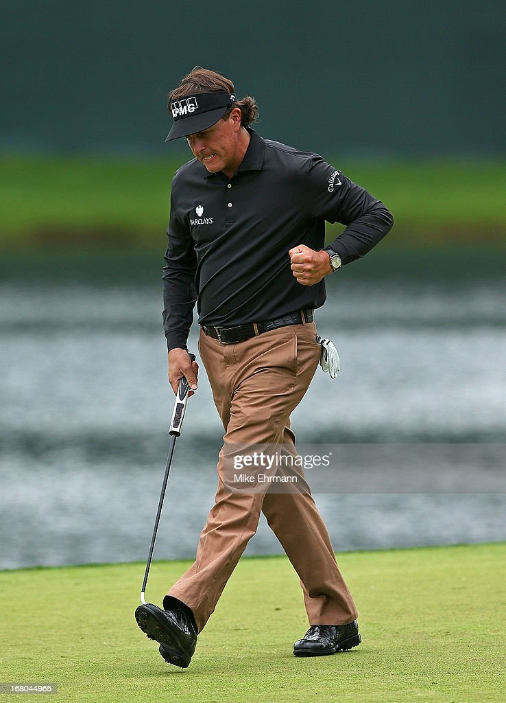 Phil Mickelson reacts to a birdie on the 14th hole during the third round of the Wells Fargo Championship at Quail Hollow Club on May 4, 2013 in Charlotte, North Carolina.