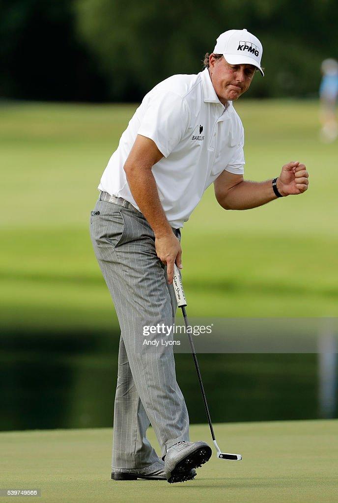 Phil Mickelson reacts to a birdie putt on the 12th green during the final round of the FedEx St. Jude Classic at TPC Southwind on June 12, 2016 in Memphis, Tennessee.