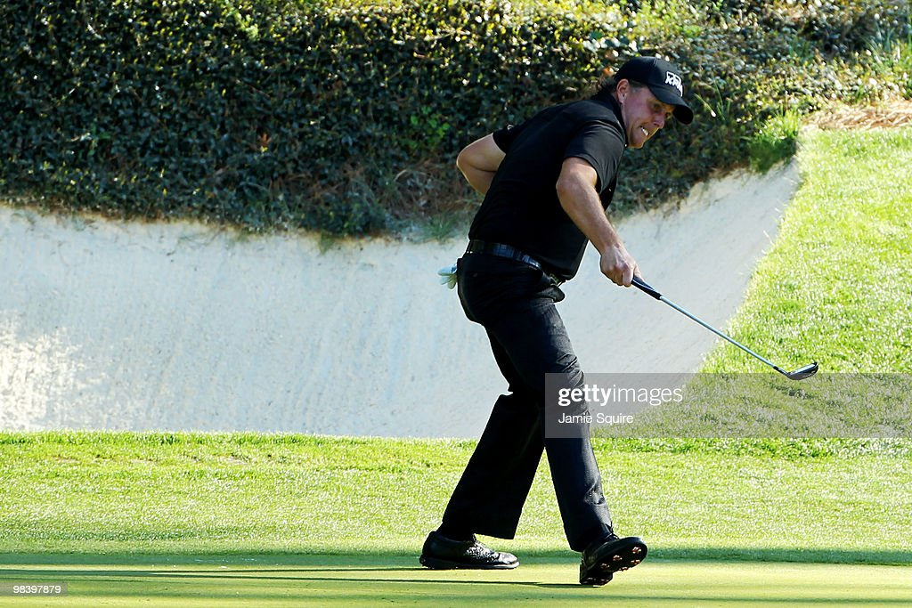 Phil Mickelson reacts to a birdie putt on the 12th green during the final round of the 2010 Masters Tournament at Augusta National Golf Club on April 11, 2010 in Augusta, Georgia.