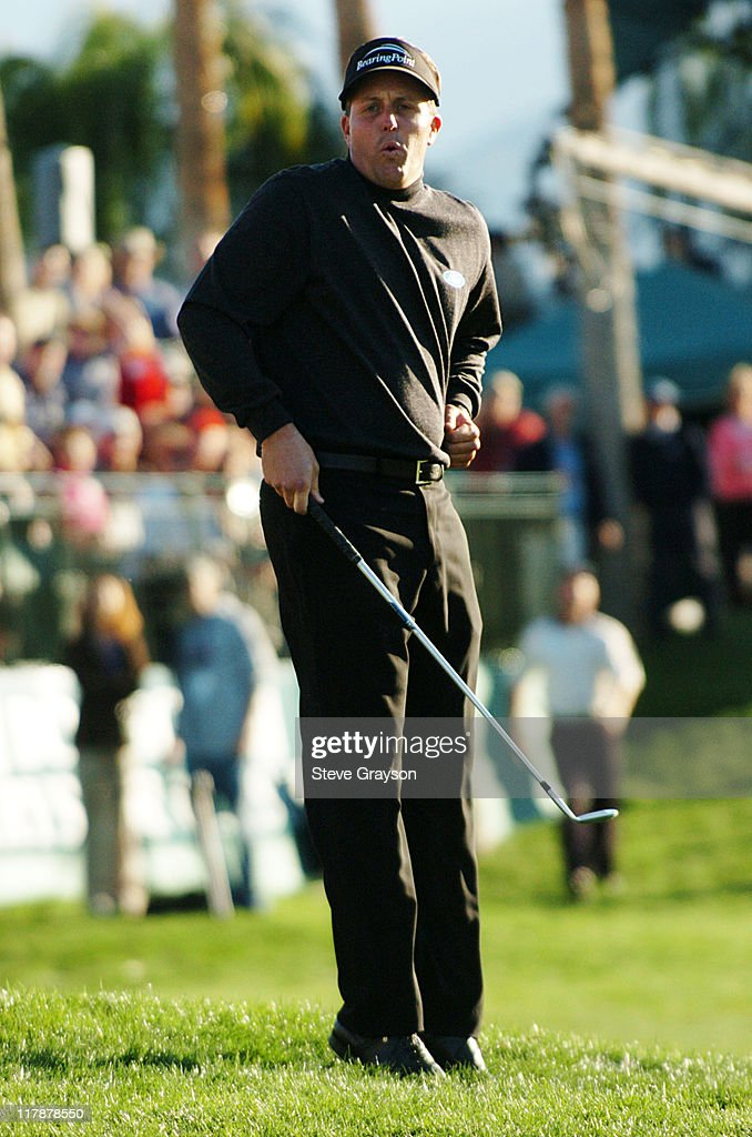 Phil Mickelson reacts to a missed birdie putt on the 18th green during the final round of the 45th Annual Bob Hope Chrysler Classic at PGA West Arnold Palmer Private Course in La Quinta, California January 25, 2004.