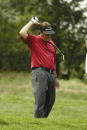 Phil Mickelson reacts to a poor shot off the 11th tee during The International on August 9 2003 at Castle Pines Golf Club in Castle Rock Colorado