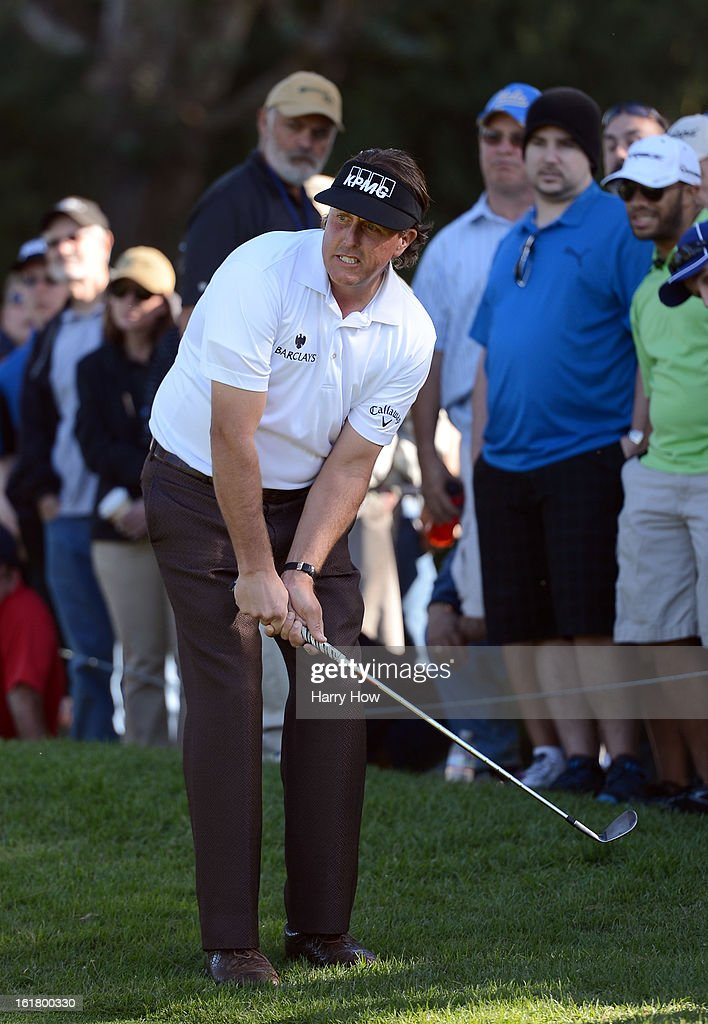Phil Mickelson reacts to his chip from the rough on the first green during the third round of the Northern Trust Open at the Riviera Country Club on February 16, 2013 in Pacific Palisades, California.