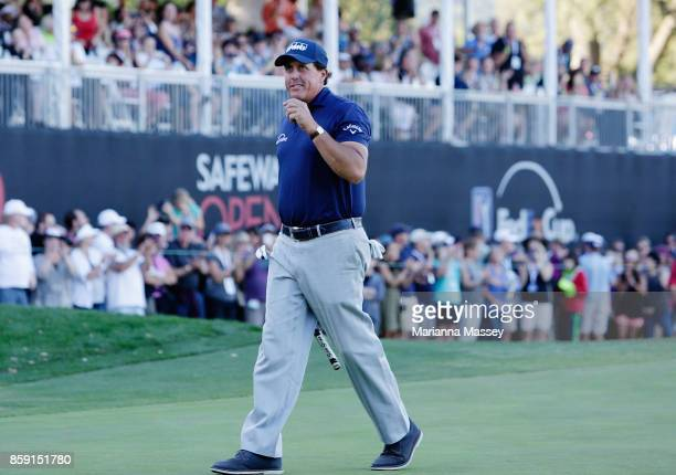 Phil Mickelson reacts to his putt and the crowd after finishing his round on the 18th hole during the final round of the Safeway Open at the North...