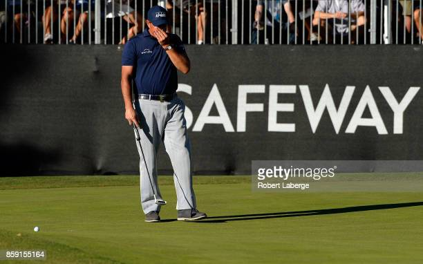 Phil Mickelson reacts to his putt on the 17th hole during the final round of the Safeway Open at the North Course of the Silverado Resort and Spa on...