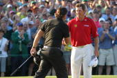 Phil Mickelson shakes hands with Lee Westwood of England on the 18th green after Mickelson's threestroke victory at the 2010 Masters Tournament at...