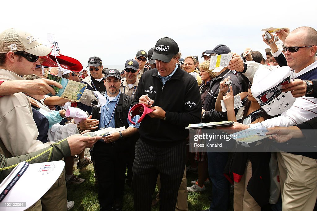 Phil Mickelson signs autographs for fans during a practice round prior to the start of the 110th U.S. Open at Pebble Beach Golf Links on June 15, 2010 in Pebble Beach, California.