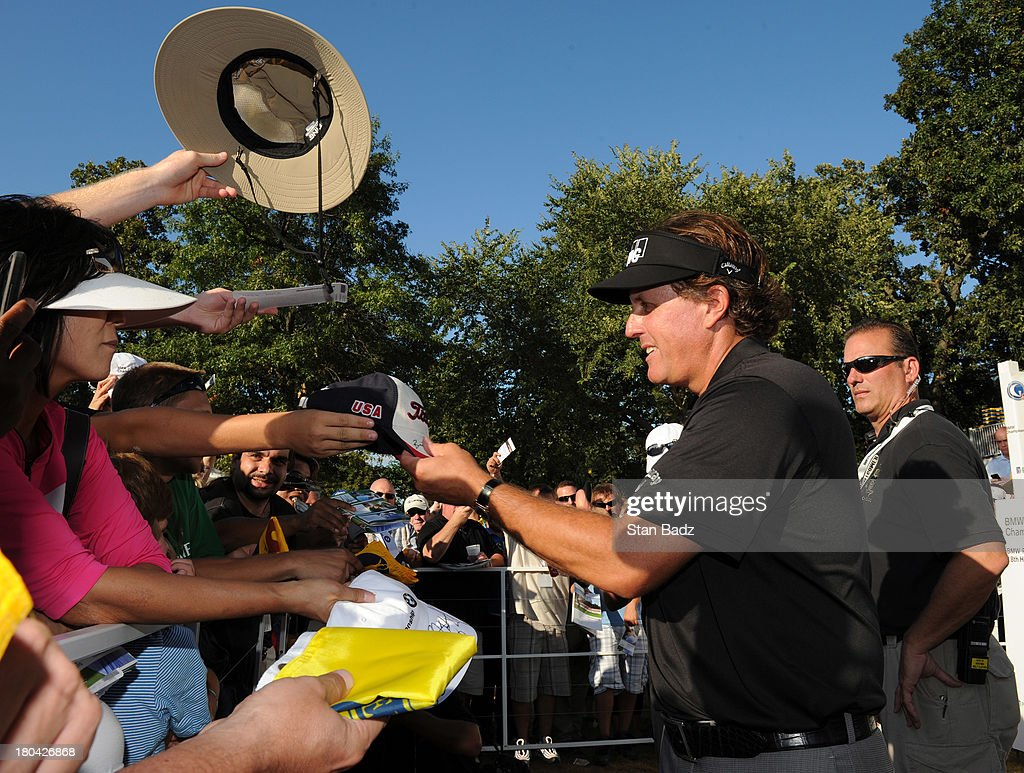 <a gi-track='captionPersonalityLinkClicked' href=/galleries/search?phrase=Phil+Mickelson&family=editorial&specificpeople=157543 ng-click='$event.stopPropagation()'>Phil Mickelson</a> signs autographs for fans during the first round of the BMW Championship at Conway Farms Golf Club on September 12, 2013 in Lake Forest, Illinois.