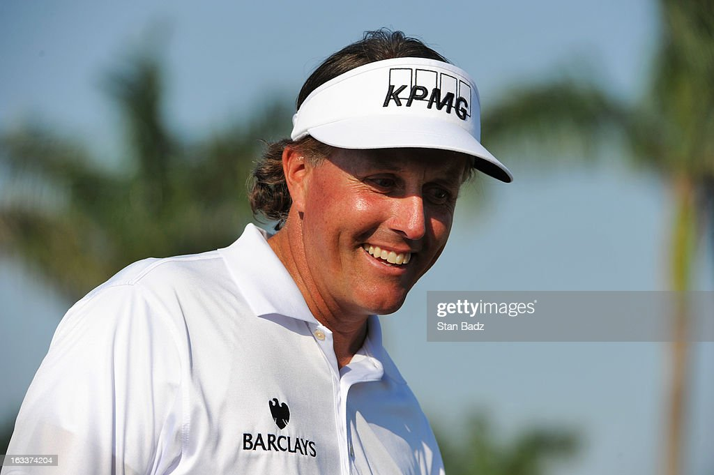 Phil Mickelson smiles after making his birdie putt on the ninth hole during the second round of the World Golf Championships-Cadillac Championship at TPC Blue Monster at Doral on March 8, 2013 in Doral, Florida.