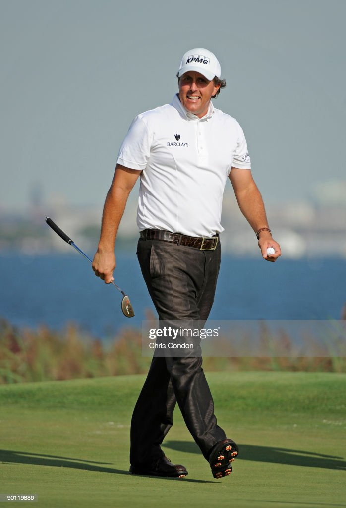 Phil Mickelson smiles as he walks off the 14th green during the first round of The Barclays at Liberty National Golf Club on August 27 2009 in Jersey...
