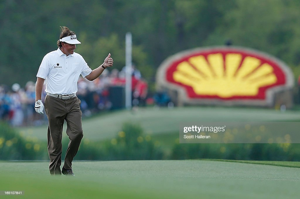 Phil Mickelson smiles as he walks up the 18th fairway during the third round of the Shell Houston Open at the Redstone Golf Club on March 30, 2013 in Humble, Texas.
