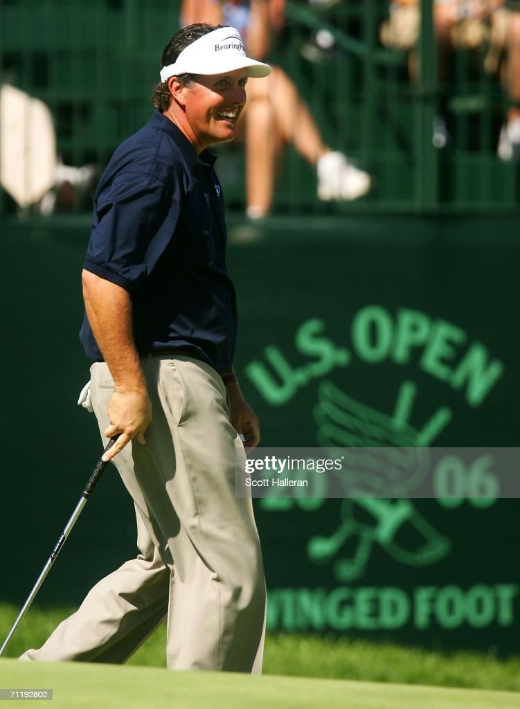 Phil Mickelson smiles as walks across a green during the Tuesday practice round for the 2006 US Open Championship at Winged Foot Golf Club on June 13...