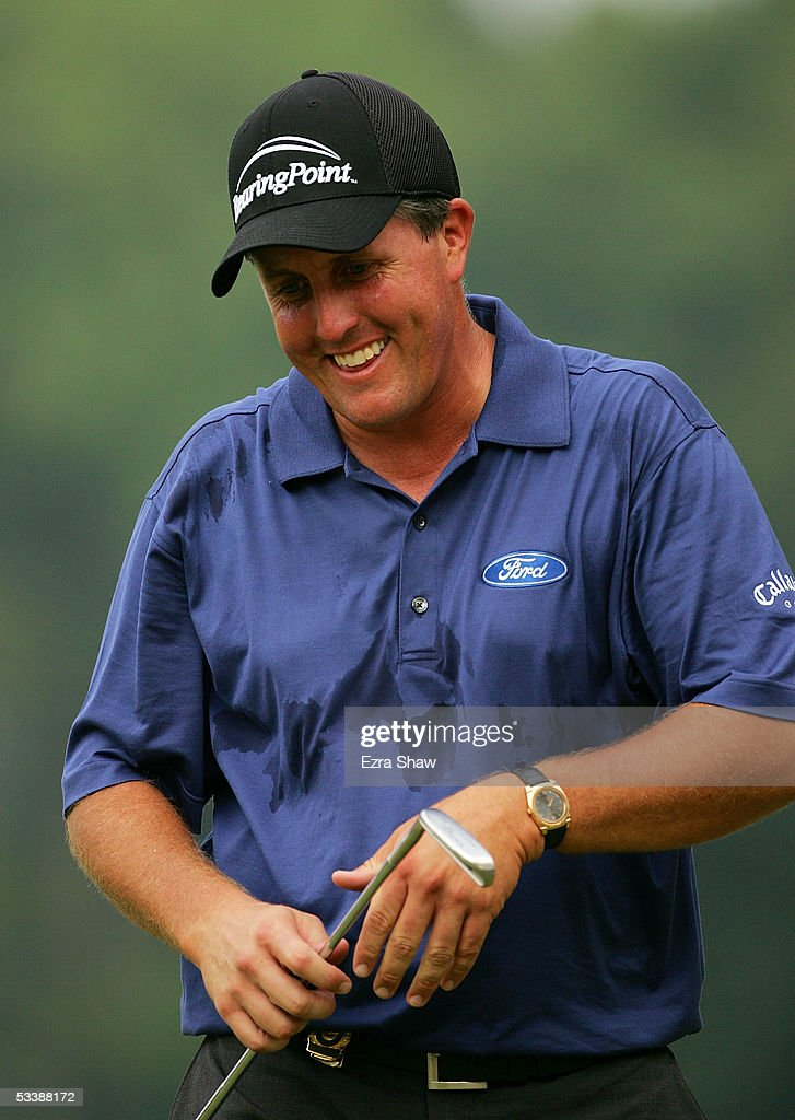 Phil Mickelson smiles as we walks up to the 12th green during the final round of the 2005 PGA Championship at Baltusrol Golf Club on August 14, 2005 in Springfield, New Jersey.