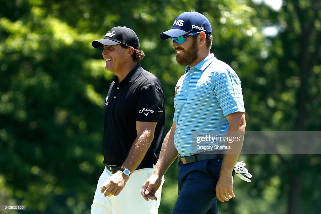 <a gi-track='captionPersonalityLinkClicked' href=/galleries/search?phrase=Phil+Mickelson&family=editorial&specificpeople=157543 ng-click='$event.stopPropagation()'>Phil Mickelson</a> speaks to <a gi-track='captionPersonalityLinkClicked' href=/galleries/search?phrase=Louis+Oosthuizen&family=editorial&specificpeople=241573 ng-click='$event.stopPropagation()'>Louis Oosthuizen</a> of South Africa as they walk off the eighth tee during the first round of the World Golf Championships - Bridgestone Invitational at Firestone Country Club South Course on June 30, 2016 in Akron, Ohio.