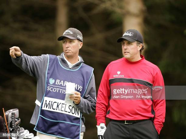 Phil Mickelson speaks with his caddy at the Second during The Barclays Scottish Open at Loch Lomond Glasgow