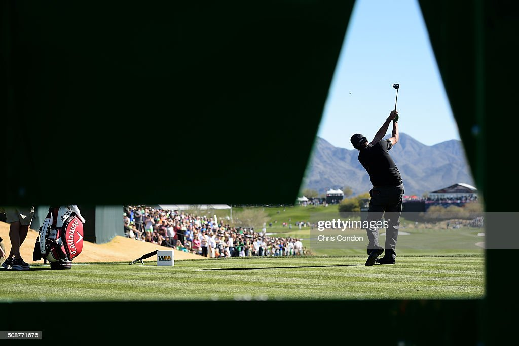 <a gi-track='captionPersonalityLinkClicked' href=/galleries/search?phrase=Phil+Mickelson&family=editorial&specificpeople=157543 ng-click='$event.stopPropagation()'>Phil Mickelson</a> tees off on the 17th hole during the third round of the Waste Management Phoenix Open, at TPC Scottsdale on February 6, 2016 in Scottsdale, Arizona.