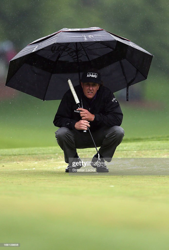 Phil Mickelson waits to hit a shot during the final round of the Wells Fargo Championship at Quail Hollow Club on May 5, 2013 in Charlotte, North Carolina.