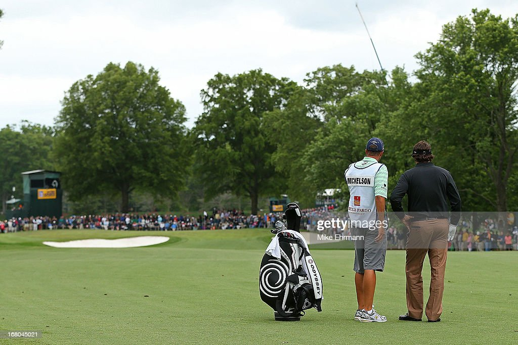 Phil Mickelson waits to hit his approach shot on the 14th hole during the third round of the Wells Fargo Championship at Quail Hollow Club on May 4, 2013 in Charlotte, North Carolina.