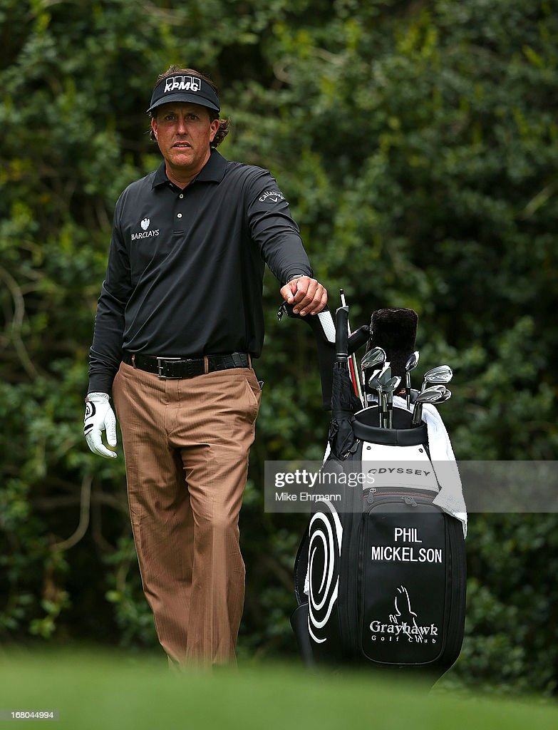 <a gi-track='captionPersonalityLinkClicked' href=/galleries/search?phrase=Phil+Mickelson&family=editorial&specificpeople=157543 ng-click='$event.stopPropagation()'>Phil Mickelson</a> waits to hit his tee shot on the 14th hole during the third round of the Wells Fargo Championship at Quail Hollow Club on May 4, 2013 in Charlotte, North Carolina.