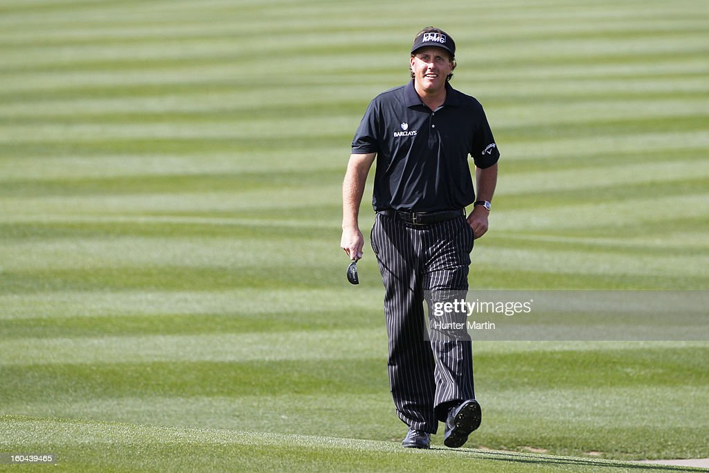 Phil Mickelson walks down the fairway on the ninth hole during the first round of the Waste Management Phoenix Open at TPC Scottsdale on January 31, 2013 in Scottsdale, Arizona.