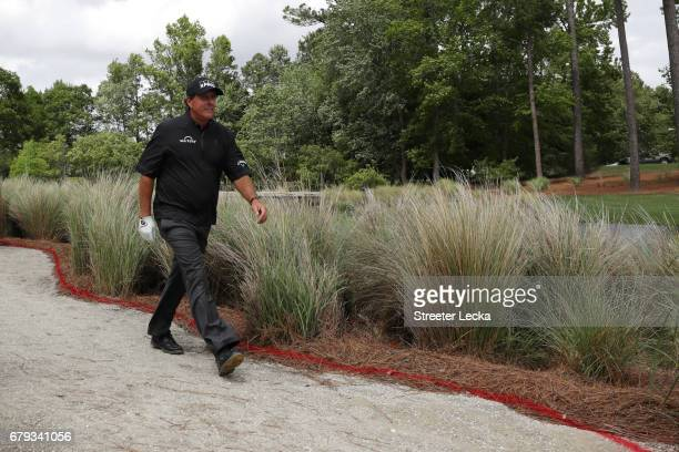 Phil Mickelson walks on the fourth hole during round two of the Wells Fargo Championship at Eagle Point Golf Club on May 5 2017 in Wilmington North...