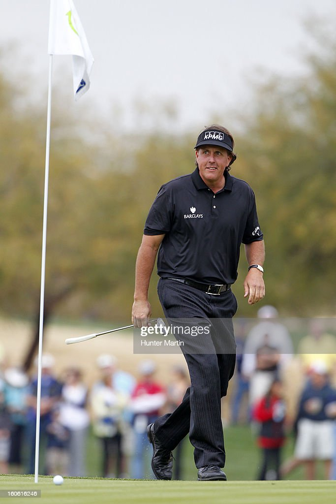 Phil Mickelson walks to his ball on the 15th green during the final round of the Waste Management Phoenix Open at TPC Scottsdale on February 3, 2013 in Scottsdale, Arizona.
