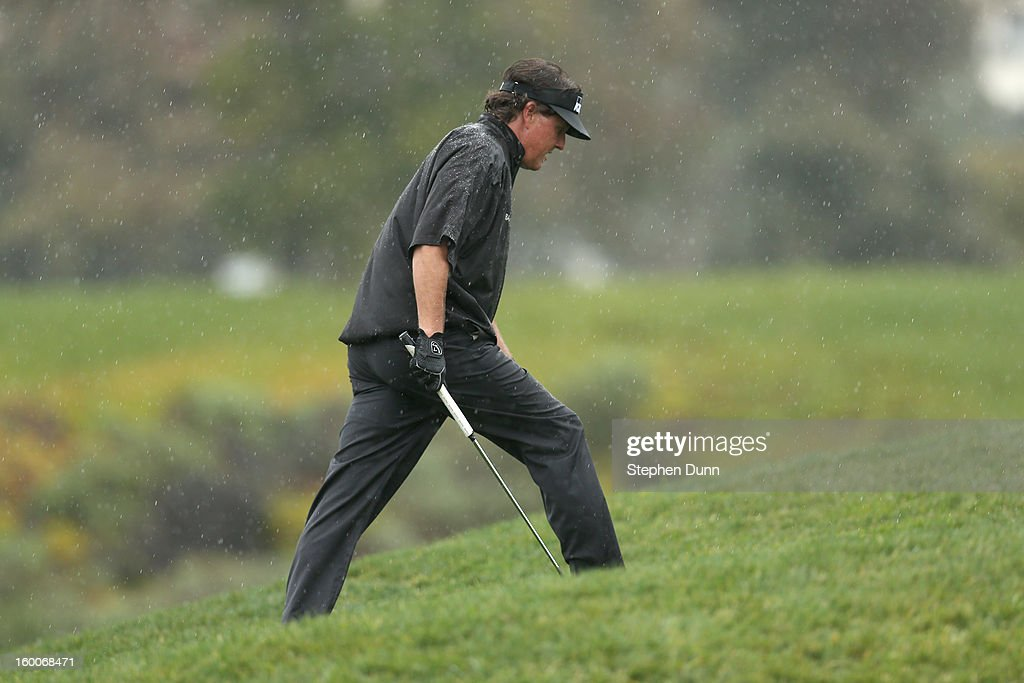 Phil Mickelson walks to the 13th green during the second round of the Farmers Insurance Open on the South Course at Torrey Pines Golf Course on January 25, 2013 in La Jolla, California.