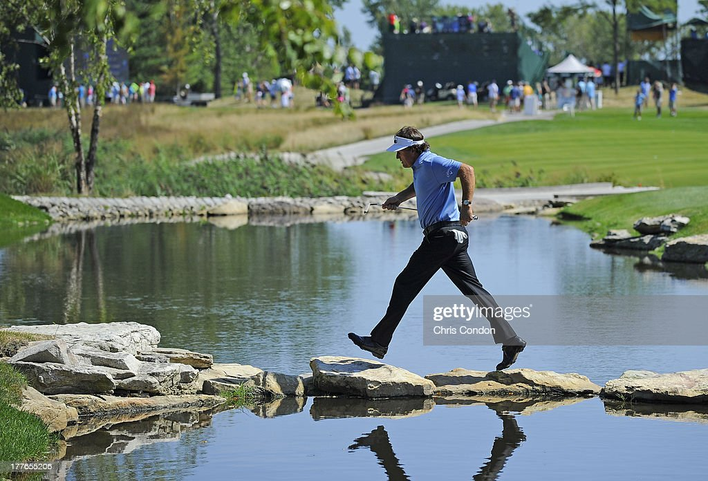 Phil Mickelson walks to the 17th tee during the final round of The Barclays at Liberty National Golf Club on August 25, 2013 in Jersey City, New Jersey.