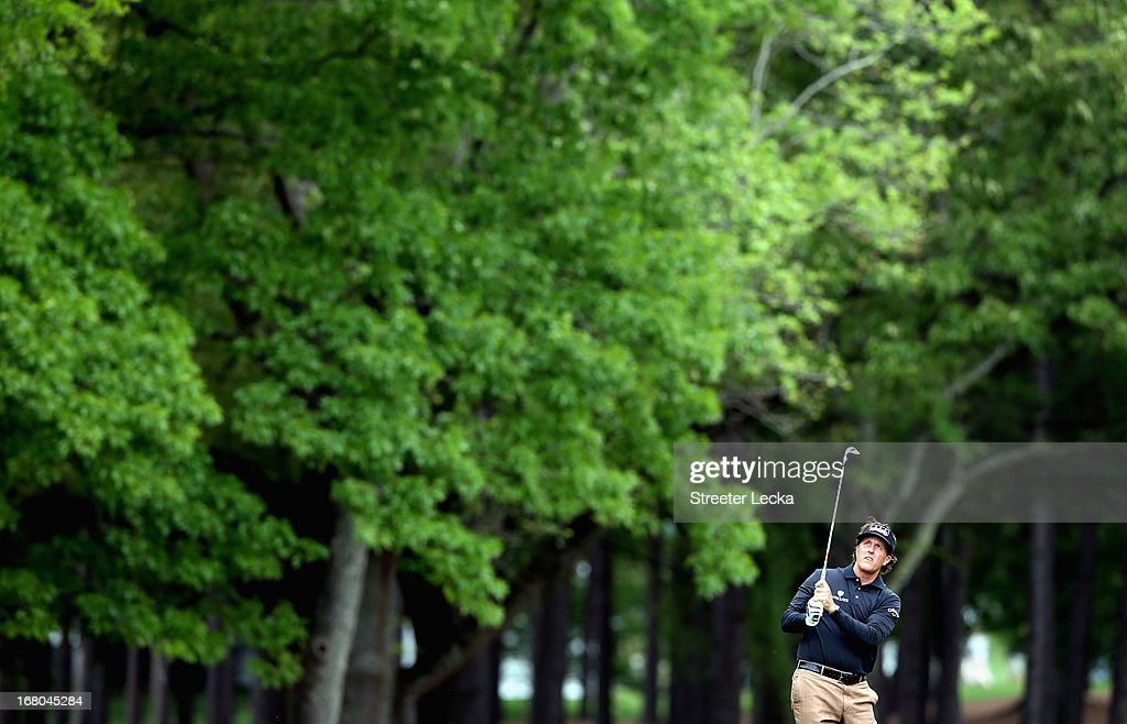 Phil Mickelson watches a shot on the 1st hole during the third round of the Wells Fargo Championship at Quail Hollow Club on May 4, 2013 in Charlotte, North Carolina.