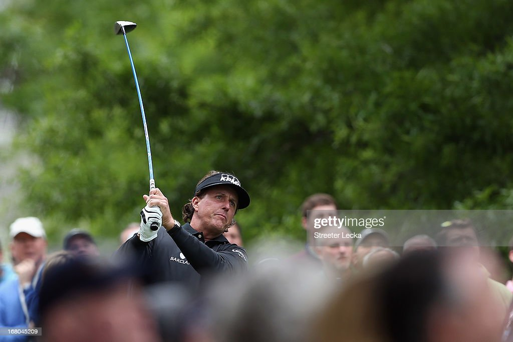 Phil Mickelson watches a tee shot on the 3rd hole during the third round of the Wells Fargo Championship at Quail Hollow Club on May 4, 2013 in Charlotte, North Carolina.