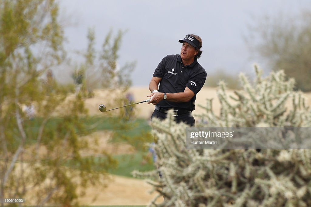 Phil Mickelson watches his second shot on the 13th hole during the final round of the Waste Management Phoenix Open at TPC Scottsdale on February 3, 2013 in Scottsdale, Arizona.