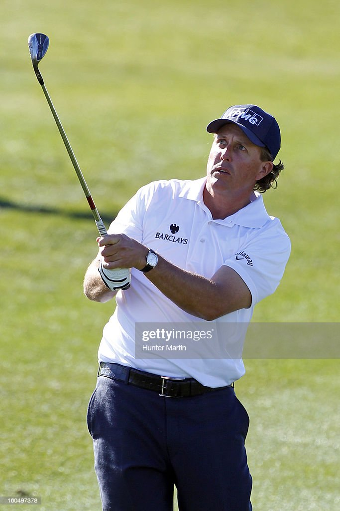 Phil Mickelson watches his second shot on the ninth hole during the second round of the Waste Management Phoenix Open at TPC Scottsdale on February 1, 2013 in Scottsdale, Arizona.