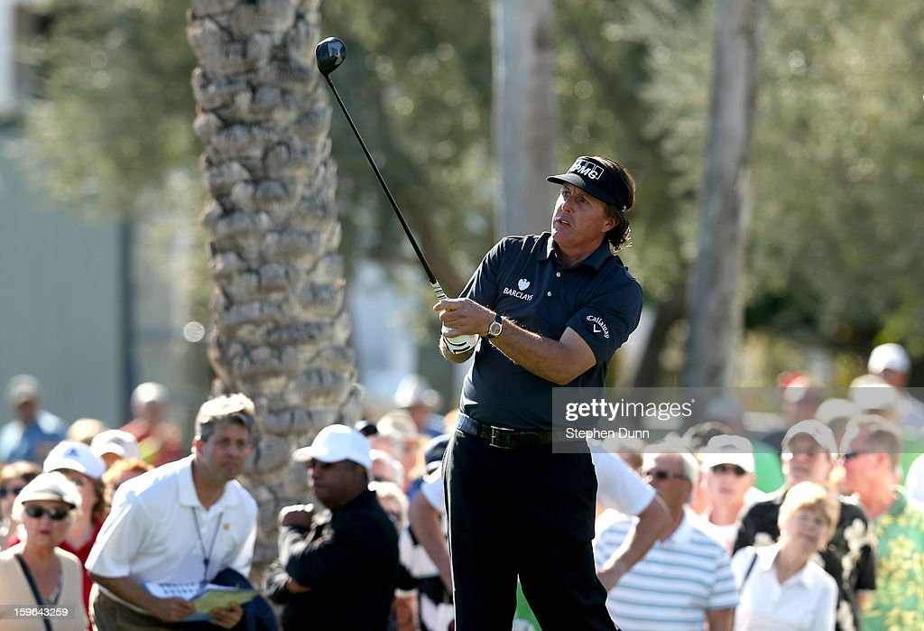 Phil Mickelson watches his tee shot on the 10th hole during the first round of the Humana Challenge in partnership with the Clinton Foundation at La Quinta Country Club on January 17, 2013 in La Quinta, California.