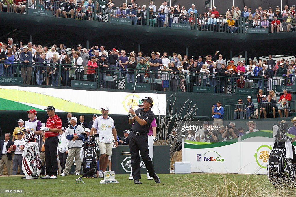 Phil Mickelson watches his tee shot on the 16th hole during the final round of the Waste Management Phoenix Open at TPC Scottsdale on February 3, 2013 in Scottsdale, Arizona.