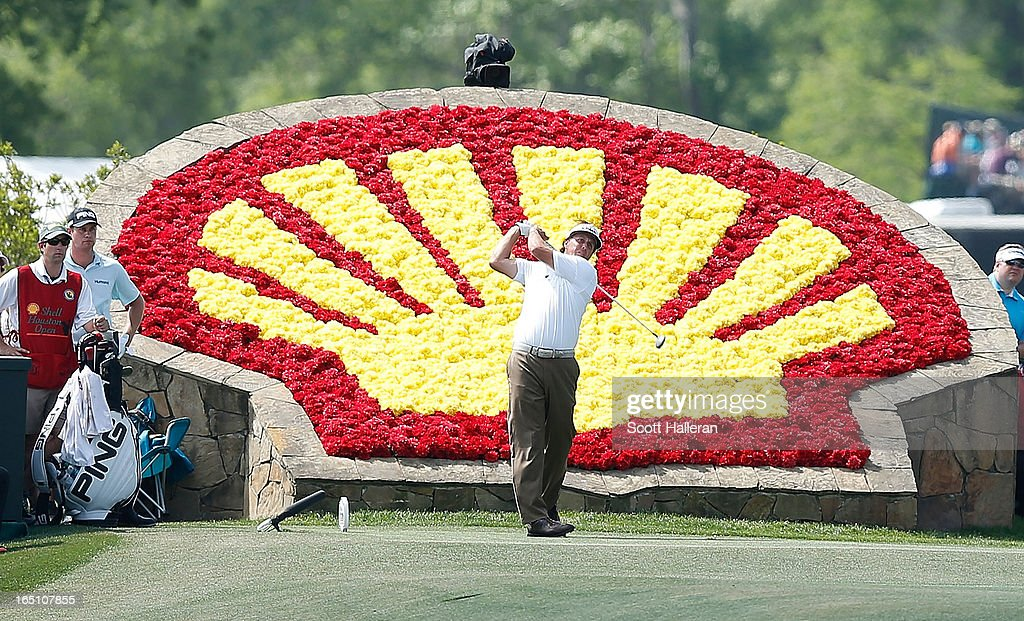 Phil Mickelson watches his tee shot on the 18th hole during the third round of the Shell Houston Open at the Redstone Golf Club on March 30, 2013 in Humble, Texas.