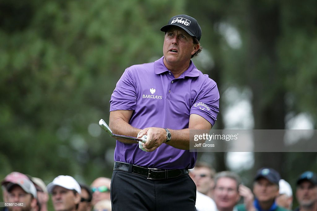 Phil Mickelson watches his tee shot on the sixth hole during the first round of the Wells Fargo Championship at Quail Hollow on May 5, 2016 in Charlotte, North Carolina.