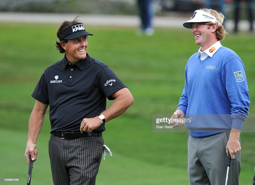 Phil Mickeslon and Brandt Snedeker exchange comments on the ninth green during the first round of the Farmers Insurance Open at Torrey Pines Golf Course on January 24, 2013 in La Jolla, California.